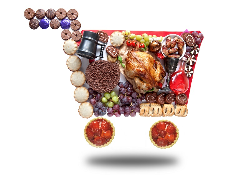 Thanksgiving and christmas groceries in the shape of a shopping cart symbol